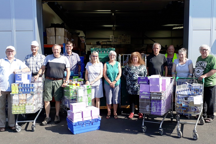 Foresters Financial team outside Norwich foodbank warehouse
